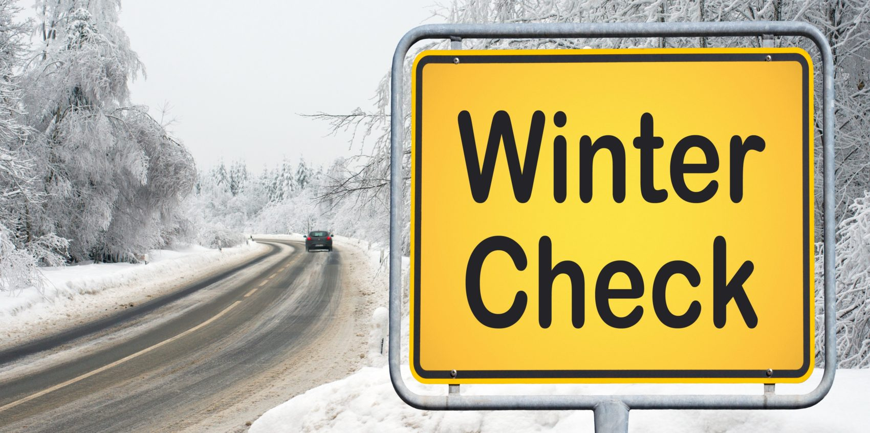 Winter Check - traffic sign with road and snow