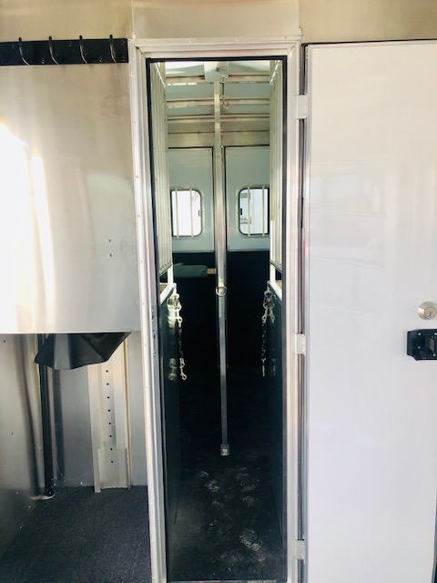 2020 Featherlite 7442 2H Straight Load Trailer Inside Tac Room Escape Door View